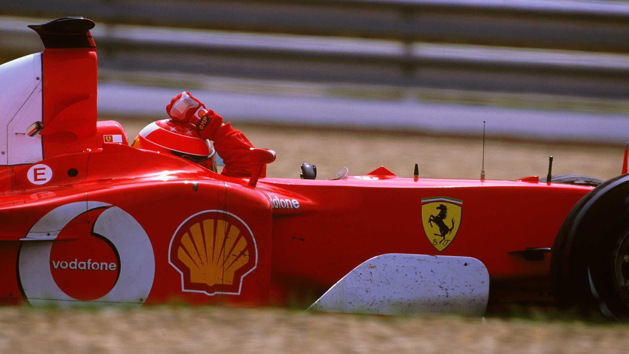 MAGNY-COURS - 21 JULY: Ferrari driver Michael Schumacher celebrates victory in the Formula One French Grand Prix at Magny-Cours in Nevers, France on July 21, 2002. Schumacher won the driver's championship to equal Fangio's record of 5 world titles. (photo by Bryn Lennon/Getty Images)