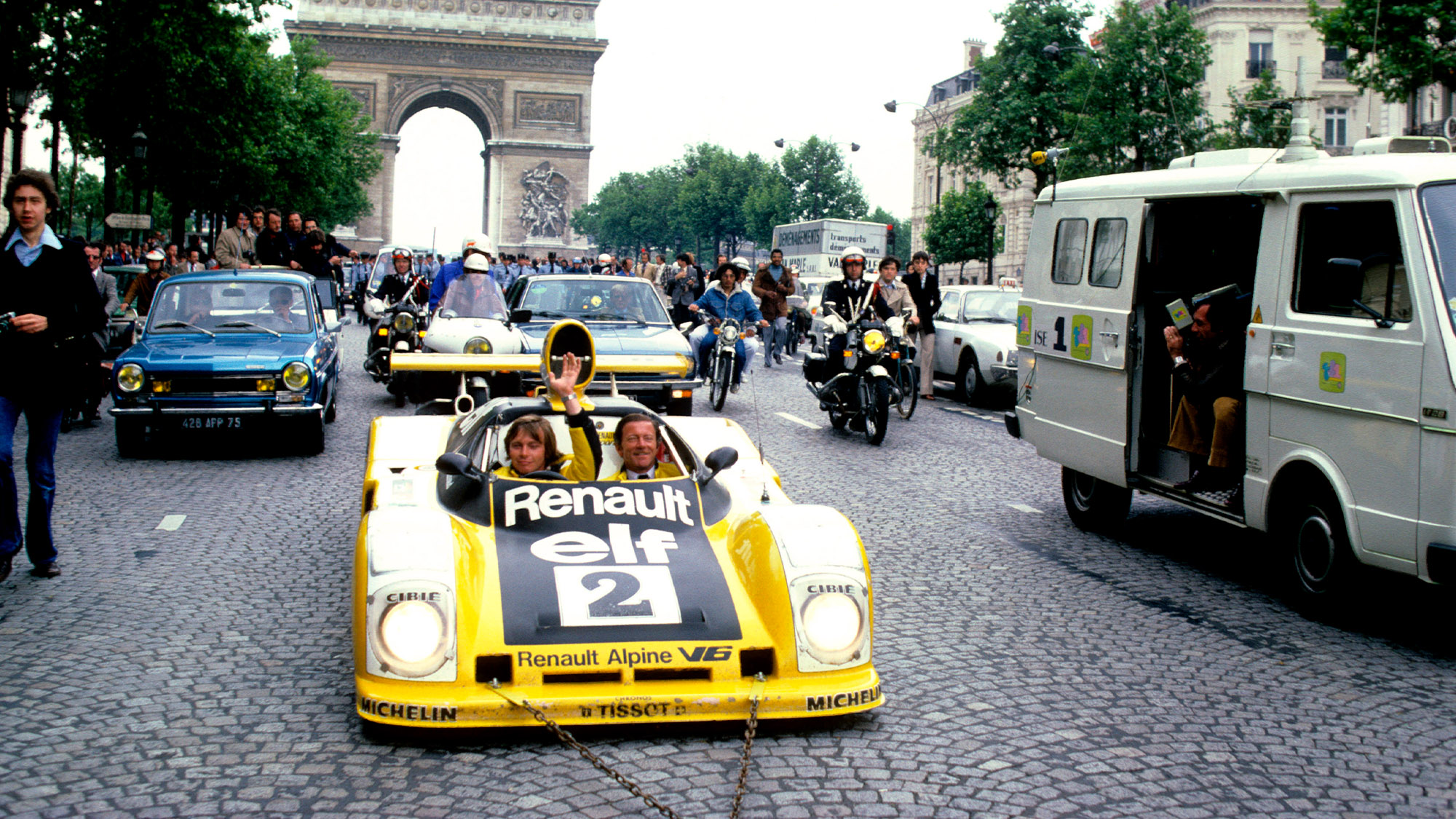 Didier Pironi and Jean-Pierre Jaussaud on the Champs Elysees in 1978 with Reanult-Alpine